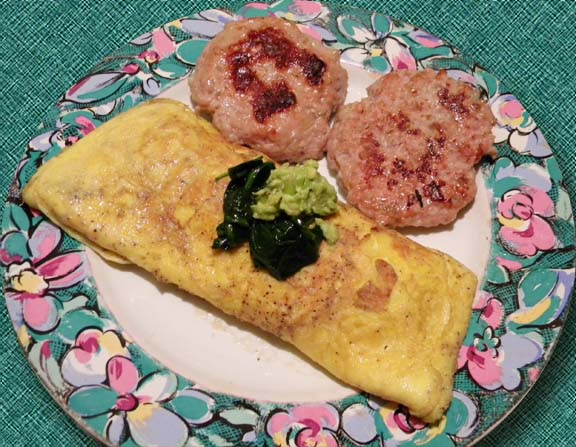 Spinach and Avocado Omelet and Pork Sausage